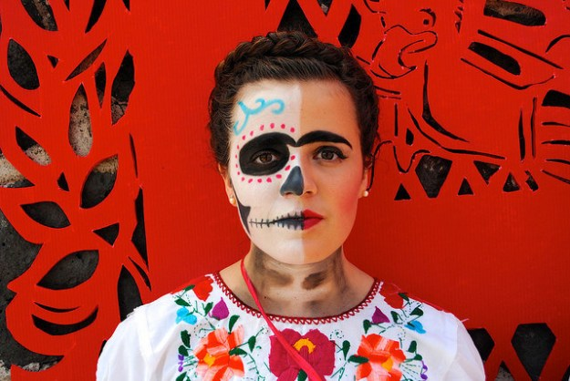 A half-painted face is meant to represent the quick transition between life and death.