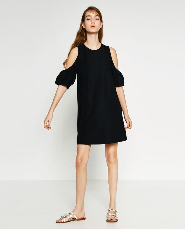 A dress with frills that can easily transition from fall to winter.