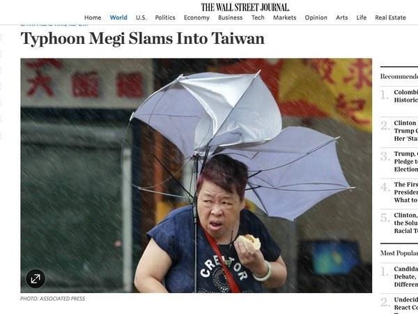 Yesterday, the Wall Street Journal published an article about the typhoon currently in Asia, with an interesting choice for a lead photo.