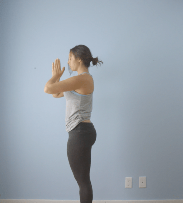 Finish your flow by stepping towards your hands, standing upright, and bringing your hands back to your heart center.