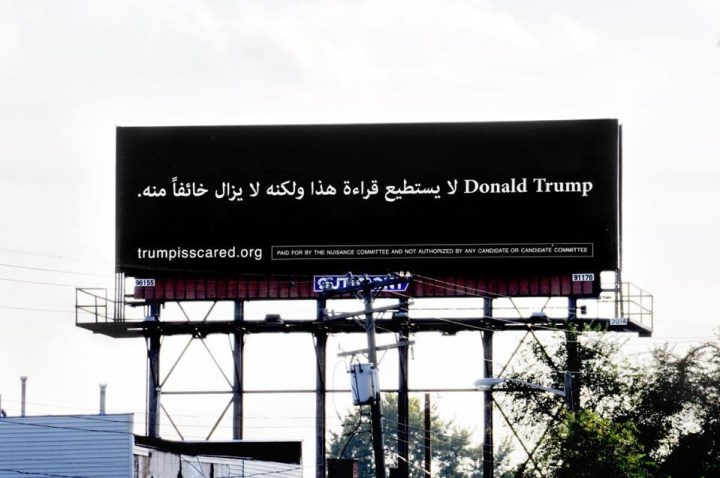 """A billboard in Arabic text reading """"Donald Trump can't read this but he's afraid of it"""" appeared on a Michigan highway on Monday."""
