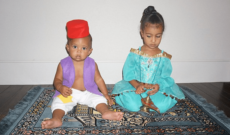 We were also treated to a rare photo of little Saint, DRESSED AS ALADDIN and sitting on a magic carpet with North.