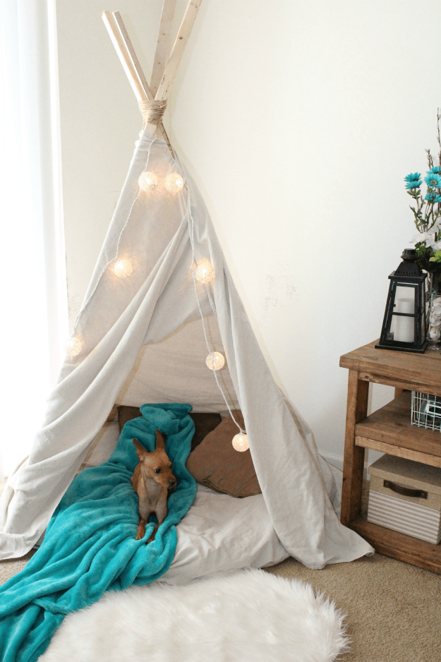 Tie the lights together in a triangle shape to make a tented hideaway for you, your kiddo, or at least your dog.