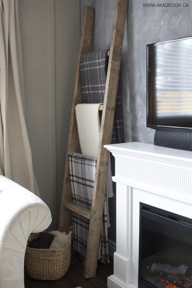 Make a ladder display for your favorite throws and blankets (for less than $25, too).