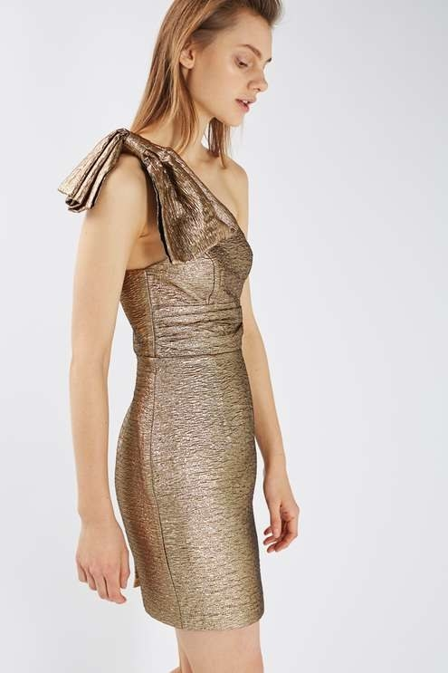 A metallic one-shoulder minidress because bows on presence > bows on presents.