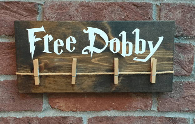 A free Dobby sign that is a refuge for missing socks and could potentially free your neighborhood house-elf.