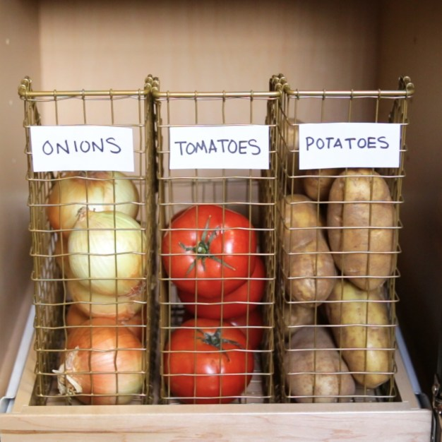 Better than keeping them in those awful crinkly bags you buy them in. This concept helps maximize shelf space by vertically stacking food that would otherwise just roll around and get squished.