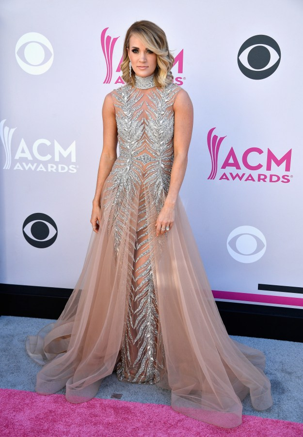Here she is looking stunning at Sunday night's ACM Awards, but what you don't see is what's going on under that dress...