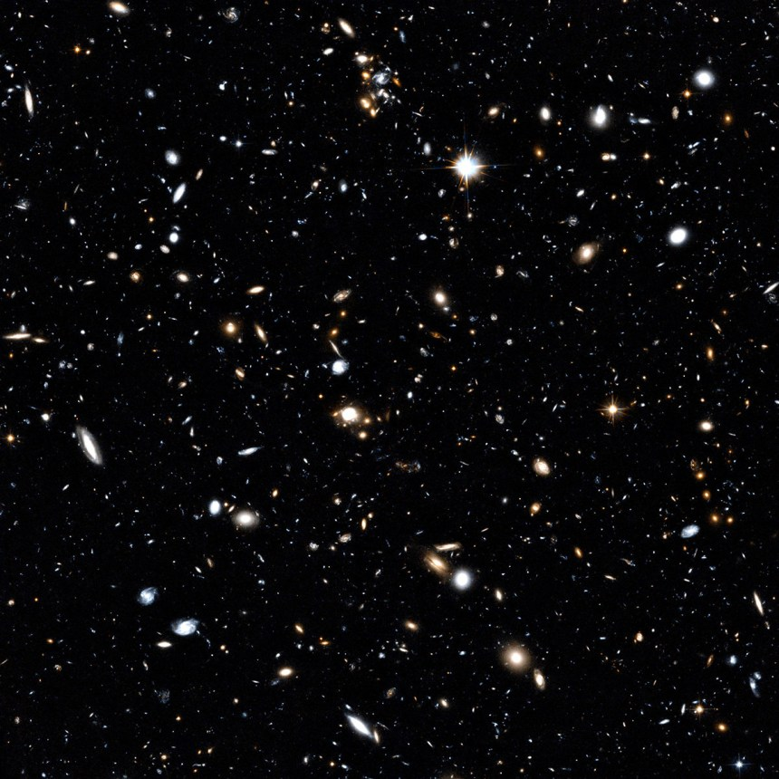 This Hubble image showcases a remarkable variety of objects at different distances from us, extending halfway to the edge of the observable universe. The galaxies in this image mostly lie about 5 billion light-years from Earth, but the field also contains other objects, both significantly closer and far more distant.