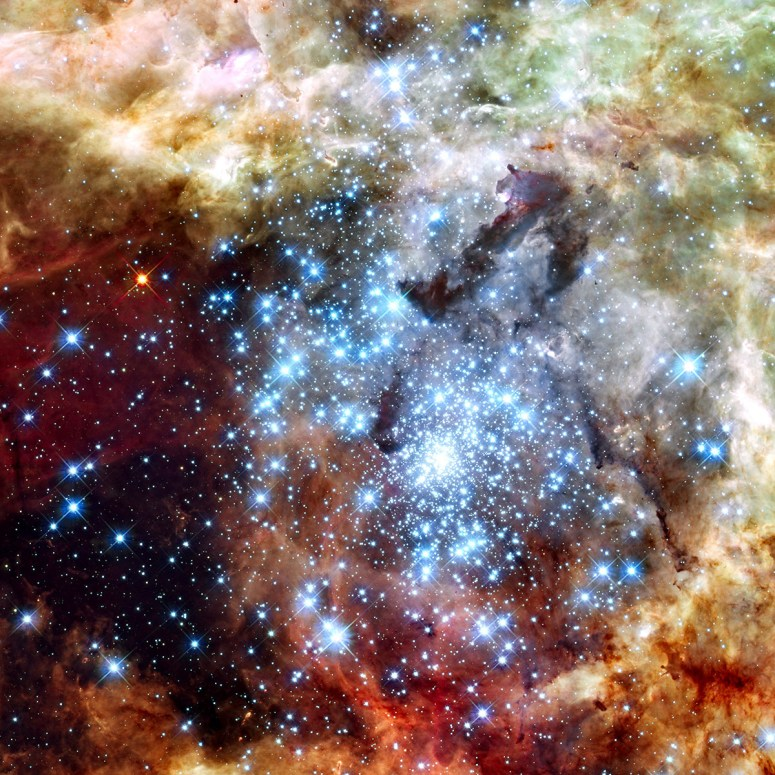 Astronomers using data from NASA's Hubble Space Telescope caught two clusters full of massive stars — called the 30 Doradus Nebula, which is 170,000 light-years from Earth — that may be in the early stages of merging. The two clusters differ in age by about 1 million years.
