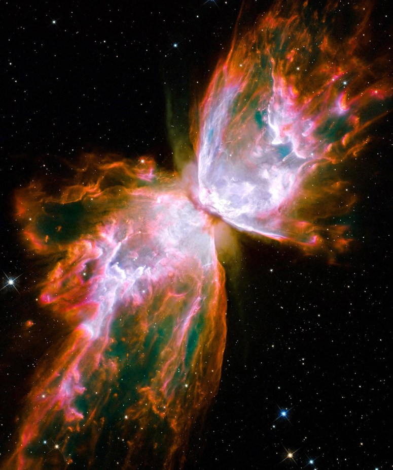 What resemble dainty butterfly wings are actually roiling cauldrons of gas heated to more than 36,000 degrees Fahrenheit. The gas is tearing across space at more than 600,000 miles an hour — fast enough to travel from Earth to the moon in 24 minutes.