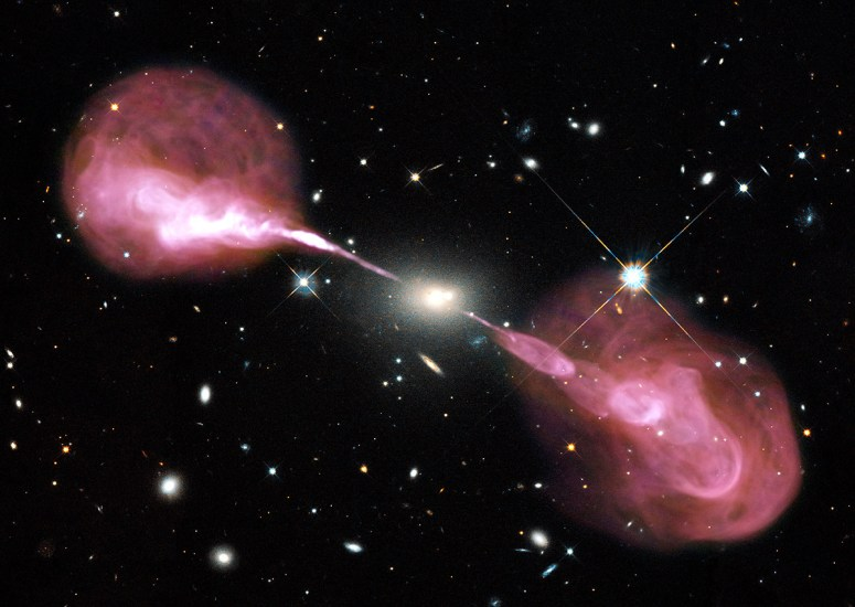 Spectacular jets powered by the gravitational energy of a supermassive black hole in the core of the elliptical galaxy Hercules A were captured by two of astronomy's cutting-edge tools, the Hubble Space Telescope's Wide Field Camera 3 and the recently upgraded Karl G. Jansky Very Large Array (VLA) radio telescope in New Mexico.