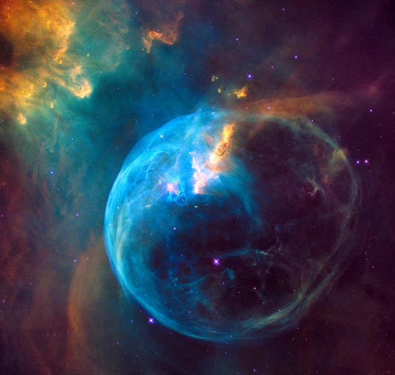 The Bubble Nebula was discovered in 1787 by William Herschel, a prominent British astronomer. It is being formed by a prototypical Wolf-Rayet star, BD +60º2522, an extremely bright, massive, and short-lived star that has lost most of its outer hydrogen and is now fusing helium into heavier elements. The star is about 4 million years old, and in 10 million to 20 million years, it will likely detonate as a supernova.