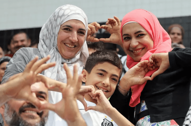 That time a young Syrian refugee and his family got to sit the stands to watch a soccer game for the first time:
