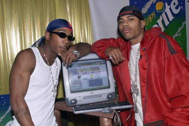 Ja Rule and Nelly next to the cool new Mac computer.