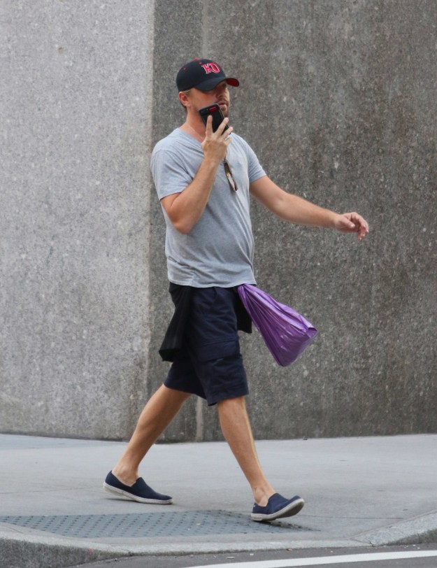 Yes, that's a BRIGHT ASS purple bag tied around the belt loop of his navy blue CARGO SHORTS, presumably used as a resourceful substitute to a fanny pack for his Oscar.