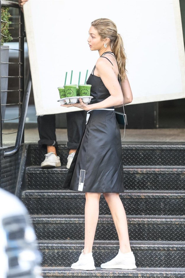 Here's Gigi Hadid modeling in NYC for a Juice Press campaign. She looks great!
