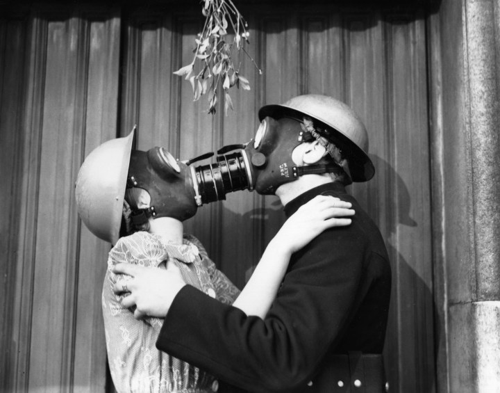 9. This gas-masked couple in London who weren't going to let the threat of a Nazi air raid ruin their holiday fun in 1940: