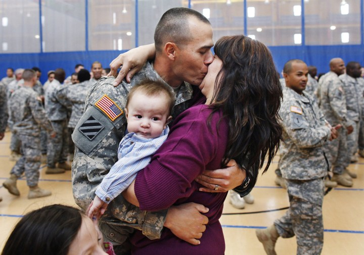 19. There's this joyous reunion between Staff Sgt. Keith Fidler and his wife Cynthia and baby boy Kolin, following his return home from Iraq in 2011: