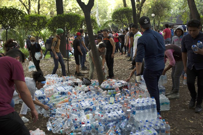 Bottled water is distributed to rescuers and victims in Mexico City.
