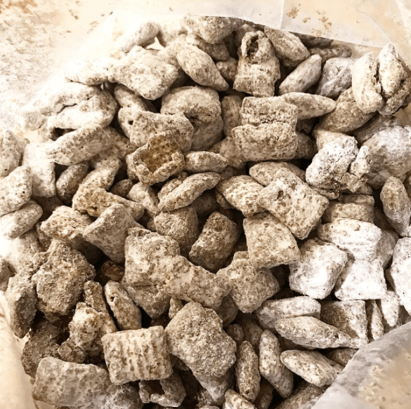 What it is: Cereal coated in melted peanut butter and chocolate tossed in as much powdered sugar as it can absorb (and then more for good measure).What it's not: Dog food.Learn how to make puppy chow here.