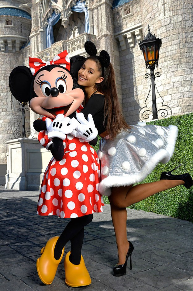 Ariana Grande hugging Minnie Mouse in her mouse ears.