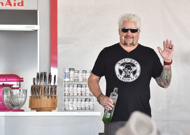 Here he is, waving at a crowd of people at the South Beach Wine and Food Festival while sporting a ~knuckle sandwich~ tee: