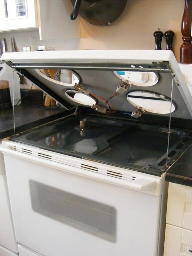 The tops of most stoves lift for easy cleaning.