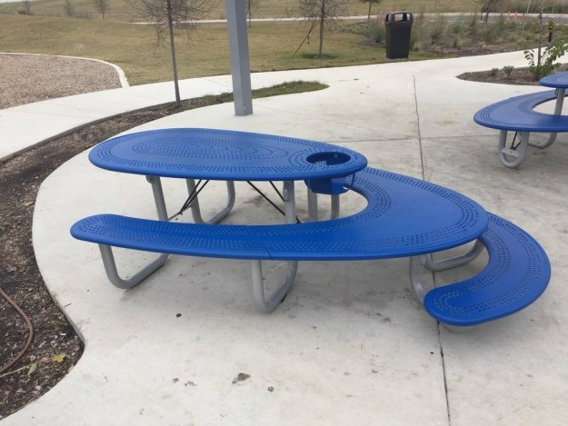 This picnic table includes an adult table, a kid's table, and a high chair.