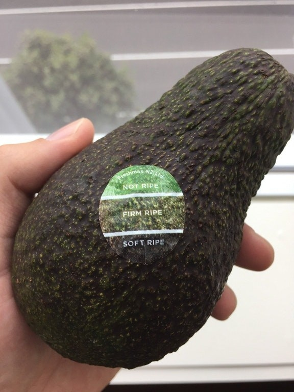 These avocados are sold with a sticker that helps you determine how ripe it is.