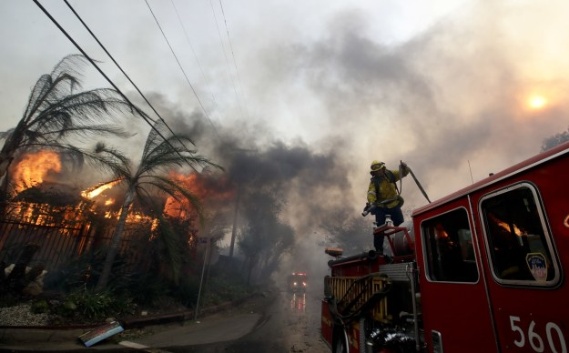 Los Angeles firefighters trying to get a handle on fires before winds pick up once again
