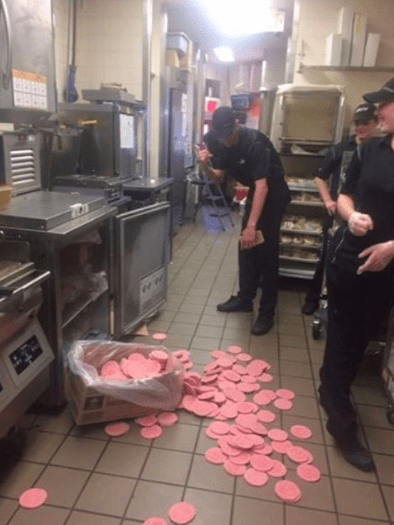 This worker, who spilled a bunch of patties: