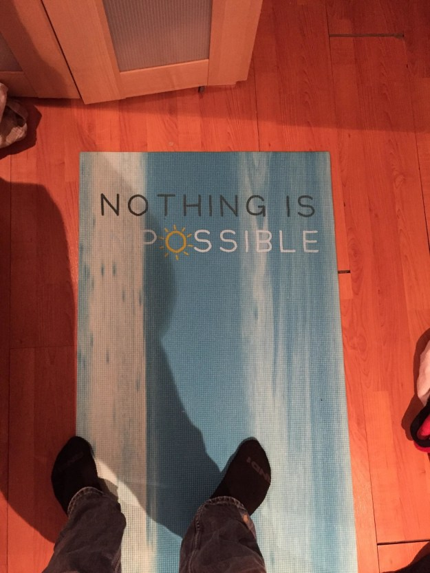 """Check out the inspirational saying I put on this yoga mat."""