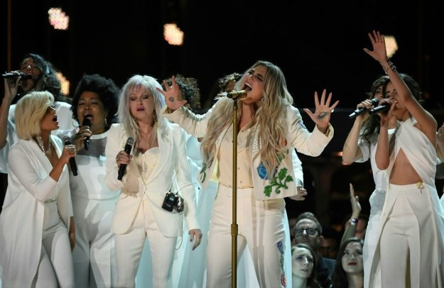 "...Kesha dedicated her performance of ""Praying"" at the Grammy's to the #MeToo movement while performing alongside other female vocalists including Cyndi Lauper, Camila Cabello, Julia Michaels, and Andra Day."