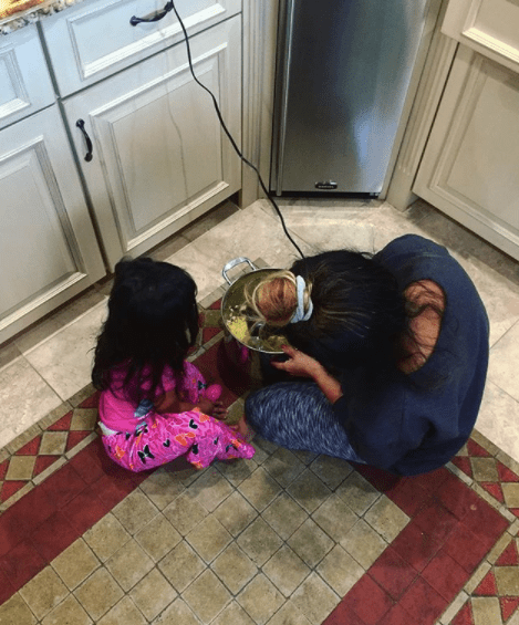 Now: She's feeding children actual food.