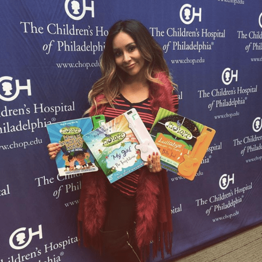 Now: She's selling children's books.