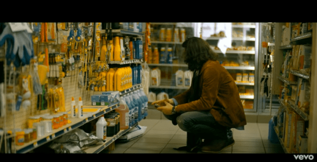 """Mayer buys the car oil himself in the video for """"Shadow Days."""""""