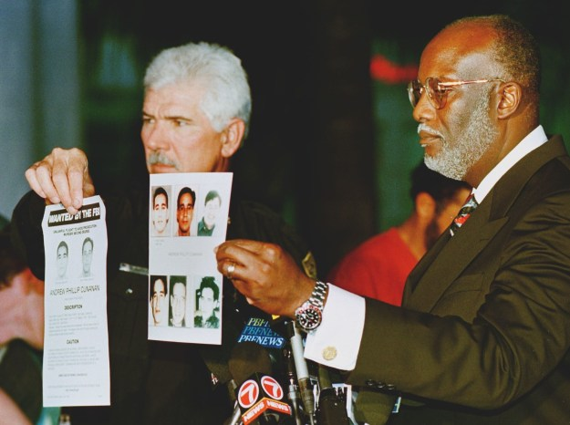 FBI Special Agent Paul Philips (right) and Miami Police Department Chief Richard Barreto (left) showed the media FBI fliers of Andrew Phillip Cunanan, the main suspect.