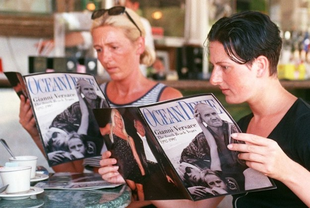 Tourists leafed through a special issue of Ocean Drive Magazine, dedicated to Versace, in Miami Beach on July 23. The magazine distributed 40,000 free copies to the area.