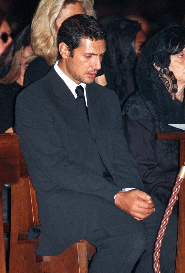 Antonio D'Amico, Versace's longtime partner, clasped his hands during the ceremony.