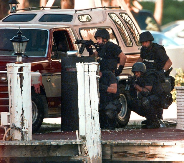 Police SWAT team members moved into position in front of the houseboat, located only blocks away from Versace's home.