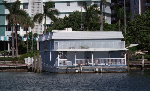 On July 23, police surrounded a houseboat on Collins Avenue in Miami Beach following reports of a break-in and unknown intruder hiding inside.