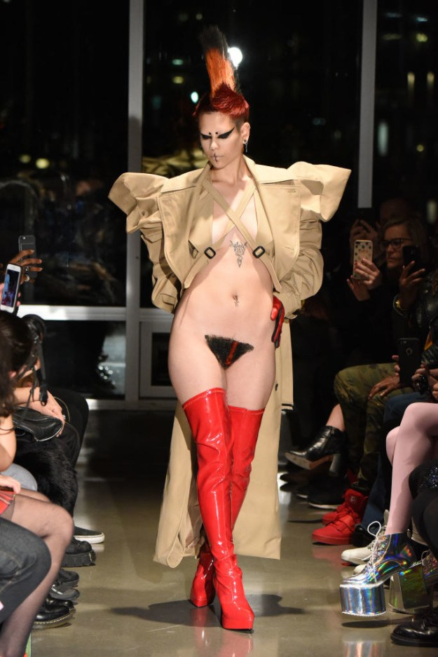 "The theme of KAIMIN's entire show was diversity and tolerance, and these punk-inspired vagina wigs (aka merkins) were chosen to represent that ""this acceptance of individuality is the human vagina — which is alluded to in the live video at the show and is emphasized by the mohawk on the runway,"" KAIMIN said in a press release."