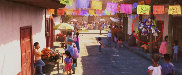 Also in Coco, Buzz, Woody, and Mike Wazowski can be seen as piñatas being sold by one of the street vendors.