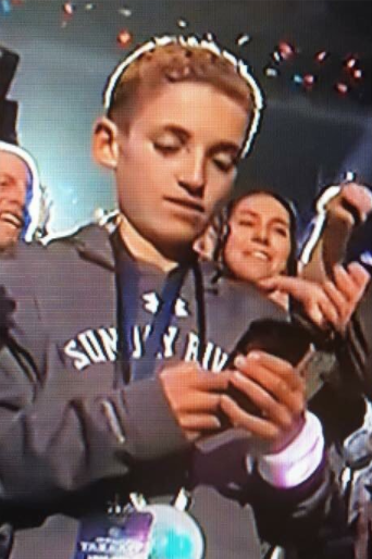 And then the kid started to play on his phone while on camera: