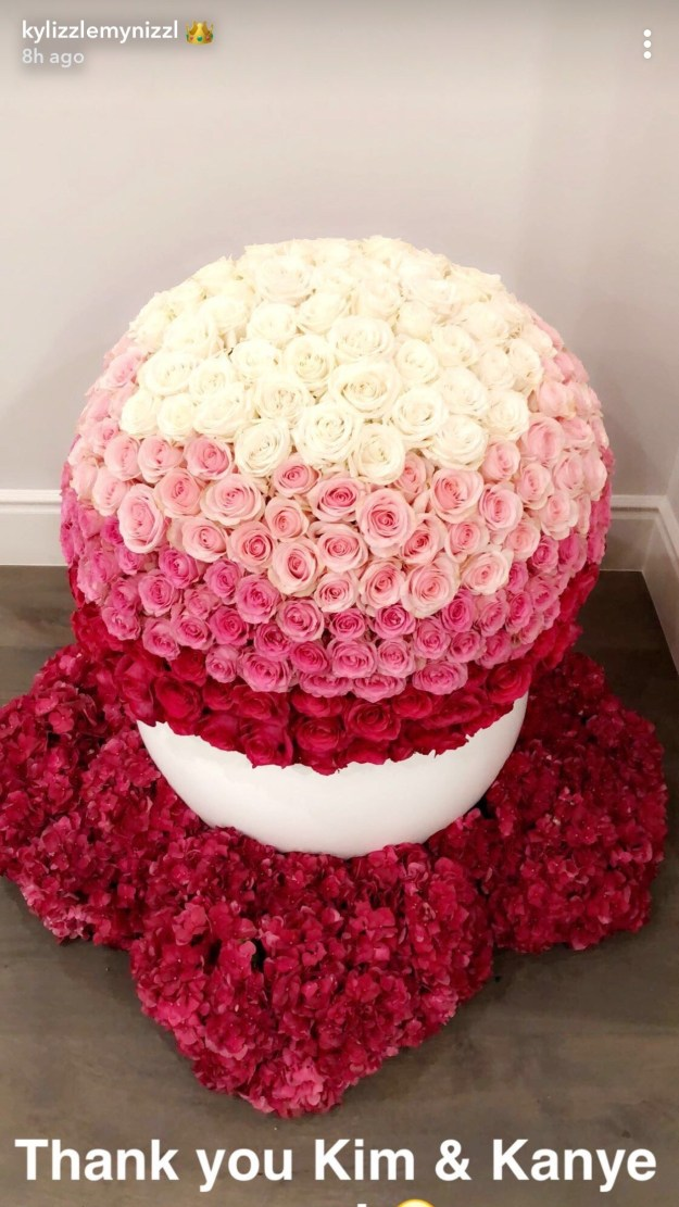 And the Kardashians were quick to congratulate Kylie, sending her enough flowers to open a florist. Kim and Kanye sent this insanely beautiful globe of flowers that's probably bigger than the average sized car.
