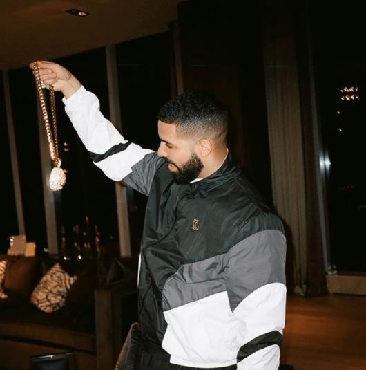Drake admired his bling.