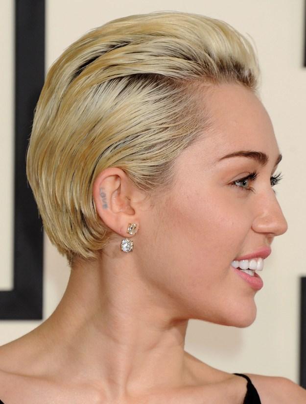 """Miley """"Love"""" ear tat."""