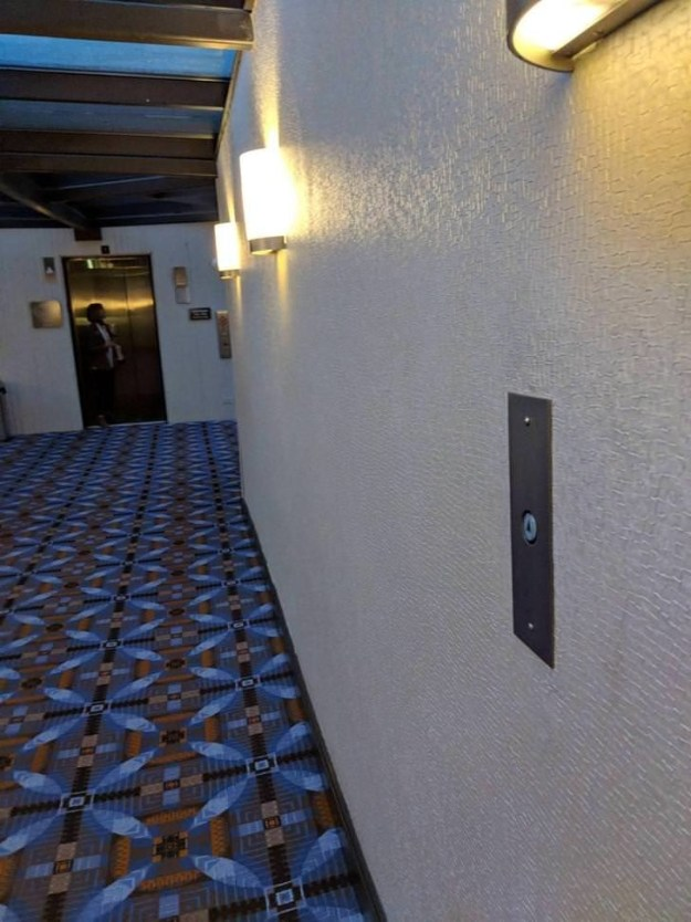 This hotel puts their elevator button in the middle of the hallway, so an elevator can be ready for you by the time you reach the doors.