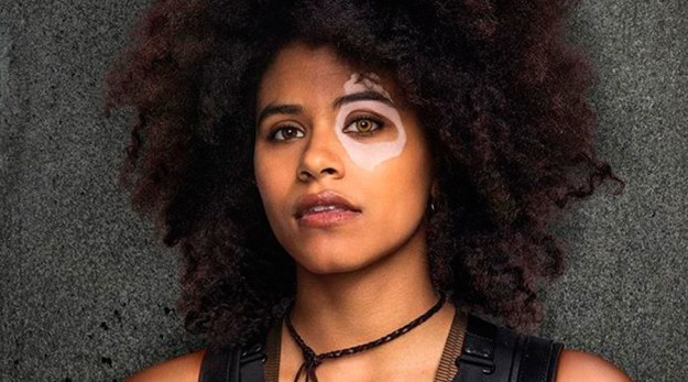 For those ~not in the know~ Domino is a mutant known for her incredible luck and the signature birthmark over her eye (making her look like a domino, hence the name).